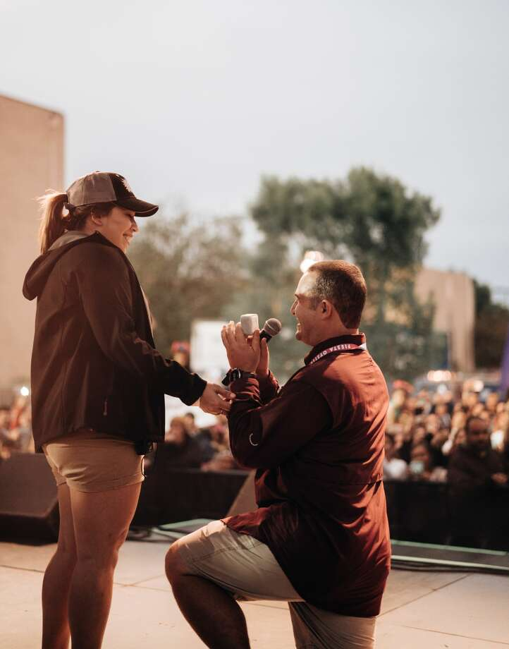 In front of hundreds gathered for an evening of music at the opening night of Oyster Bake, Tyler Walthall proposed to his now fiance Amanda Martinez, Friday, April 20, 2018. Photo: Courtesy Dillon Kirk