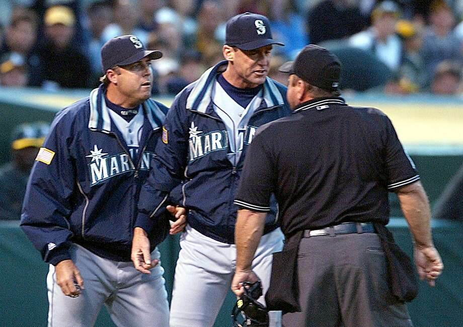 Seattle Mariners pitching coach Bryan Price, left, and manager Bob Melvin, center, argue Price's ejection from the game with crew chief Charlie Reliford, right, in the fourth inning against the Oakland Athletics Monday, July 26, 2004, in Oakland, Calif.  (AP Photo/Ben Margot) Photo: BEN MARGOT / AP