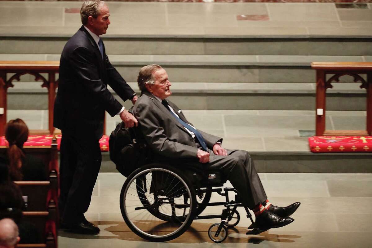 Former President George H.W. Bush, assisted by his son, former President George W. Bush, enters the church during the funeral for former first lady Barbara Bush at St. Martin's Episcopal Church on Saturday, April 21, 2018, in Houston.
