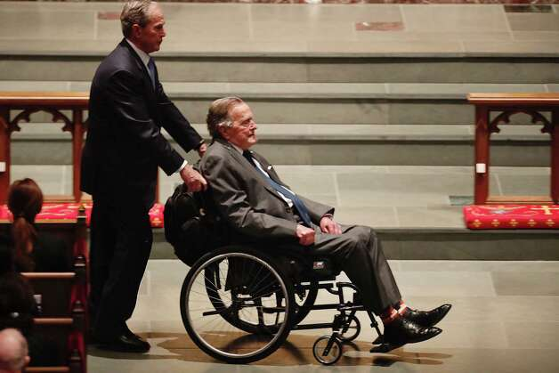 Former President George H.W. Bush, assisted by his son former President George W. Bush enter the churcj during the funeral for former First Lady Barbara Bush at St. Martin's Episcopal Church on Saturday, April 21, 2018, in Houston. Photo: Brett Coomer, Houston Chronicle / © 2018 Houston Chronicle