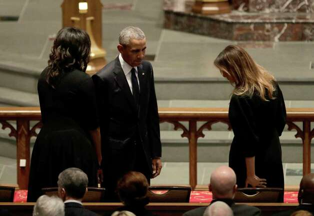 Former President Barack Obama and former first lady Michelle Obama greet first lady Melania Trump at St. Martin's Episcopal Church for a funeral service for former first lady Barbara Bush, Saturday, April 21, 2018, in Houston. (AP Photo/David J. Phillip ) Photo: David J. Phillip, Associated Press / Associated Press