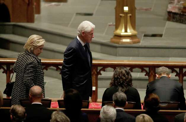 Accompanied by his wife, Hillary Clinton,left, former President Bill Clinton arrives at St. Martin's Episcopal Church for a funeral service for former first lady Barbara Bush, Saturday, April 21, 2018, in Houston. (AP Photo/David J. Phillip ) Photo: David J. Phillip, Associated Press / Associated Press