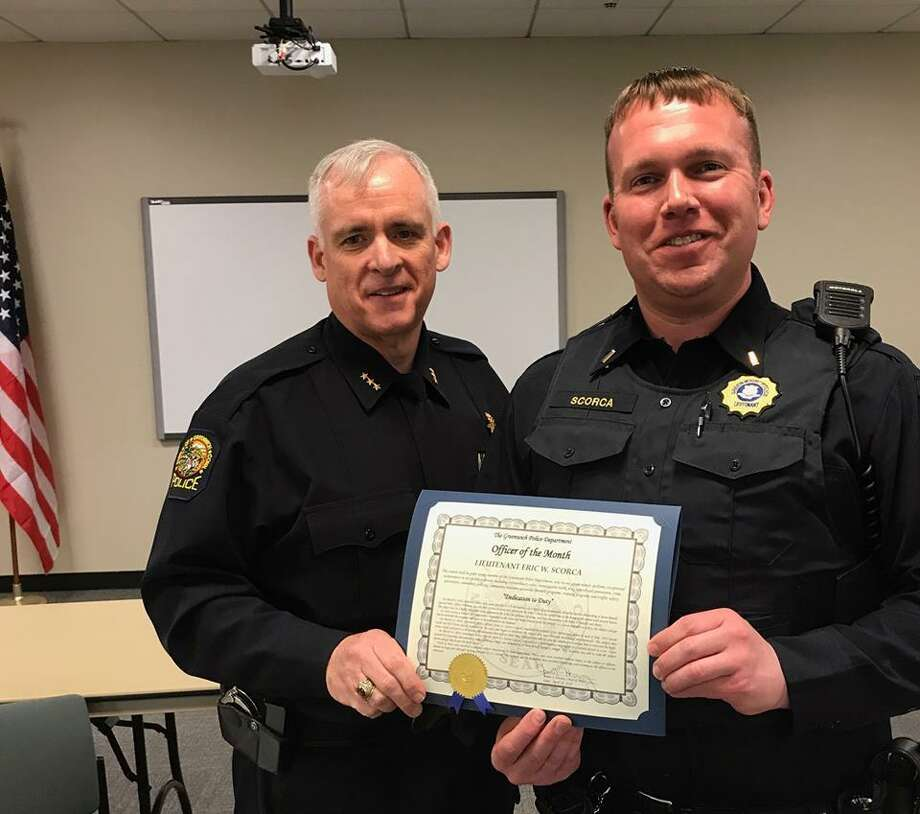 Lt. Eric Scorca, right, was named as the Officer of the Month for March. Police Chief James Heavey presented the award. Photo: / Contribued
