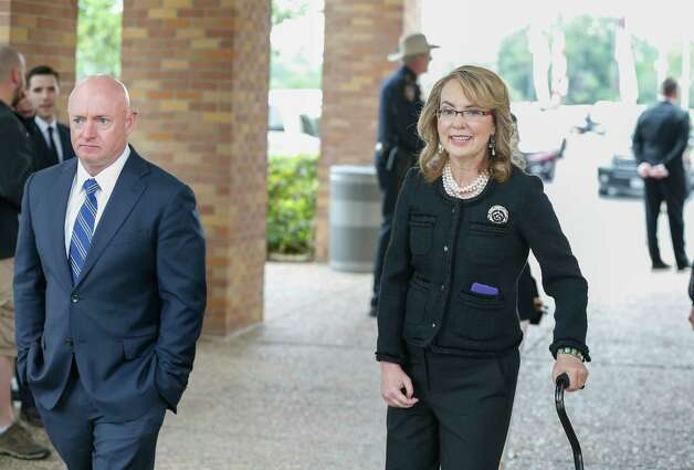 Astronaut Mark Kelly and his wife Gabby Giffords heads for shuttle buses at Second Baptist Church campus to attend Former First Lady Barbara Bush's funeral  Saturday, April 21, 2018, in Houston. Photo: Steve Gonzales, Houston Chronicle / © 2018 Houston Chronicle