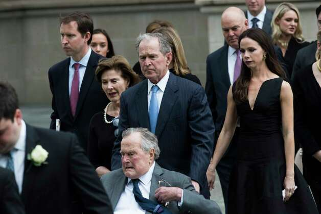 President George H. W. Bush accompanied by his son president George Bush and his family follow the casket of former First Lady Barbara Bush at the St. Martin's Episcopal Church, Saturday, April 21, 2018, in Houston. Photo: Marie D. De Jesus, Houston Chronicle / © 2018 Houston Chronicle