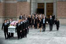 The Bush family accompanies the casket of former first lady Barbara Bush as they exit St. Martin's Episcopal Church, Saturday, April 21, 2018, in Houston.