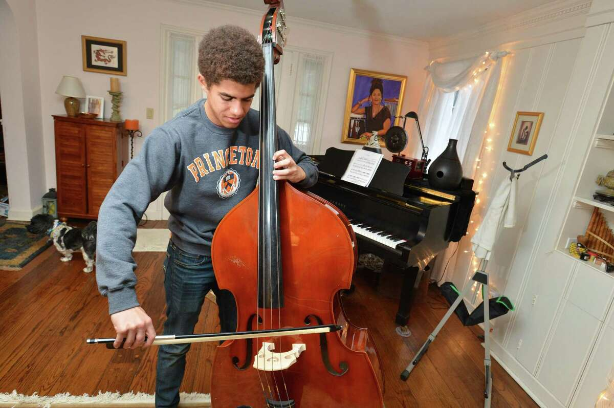 Chaz Bethel-Brescia plays a classical selection on bass on Tuesday in Norwalk. Chaz was accepted to four ivy league shools and MIT, his senior essay was about his experience being raised by two mothers.