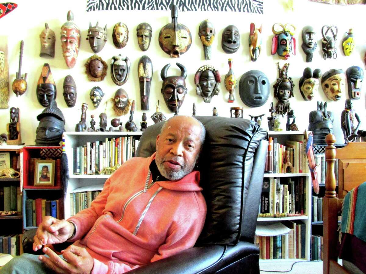 Jim Arden, who taught science at Greenwich Country Day School for 32 years, has a built a number of collections over his career, including these Africa masks, which are displayed in his home.