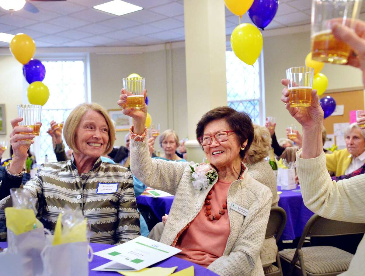 The founder of At Home in Greenwich, Marilyn Chou, center, smiled as she was honored and toasted during the 10th anniversary celebration of the At Home in Greenwich organization at the Second Congregational Church in Greenwich, Conn., April 17, 2018. The stated mission of At Home in Greenwich, according to their website is,