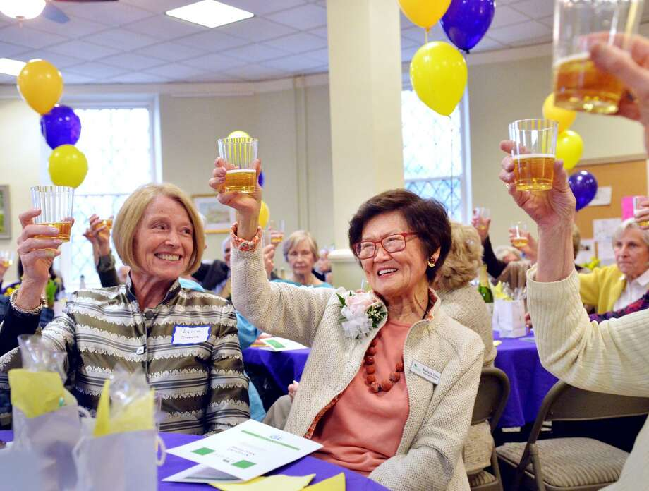 "The founder of At Home in Greenwich, Marilyn Chou, center, smiled as she was honored and toasted during the 10th anniversary celebration of the At Home in Greenwich organization at the Second Congregational Church in Greenwich, Conn., April 17, 2018. The stated mission of At Home in Greenwich, according to their website is, ""To enable Greenwich seniors to confidently age in place by providing stimulating social and educational programs and assistance with matters of health and safety."" Photo: Bob Luckey Jr. / Hearst Connecticut Media / Greenwich Time"