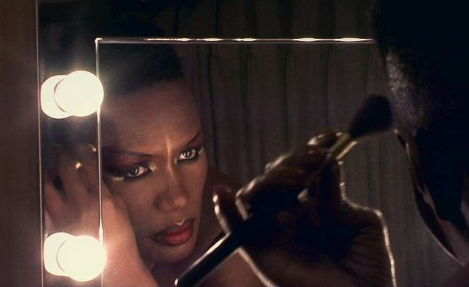 "Grace Jones puts on makeup in ""Bloodlight and Bami."" Photo: Kino Lorber"