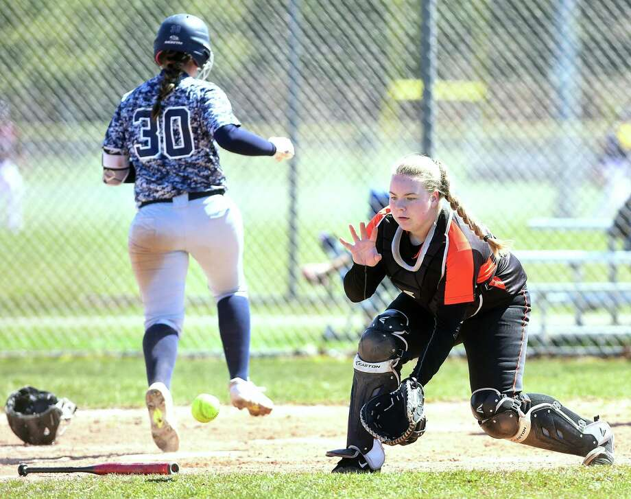 Stamford catcher Amy Covino fields the throw at the plate as Julia SanGiovanni of East Haven scores on Saturday. Photo: Arnold Gold / Hearst Connecticut Media / New Haven Register