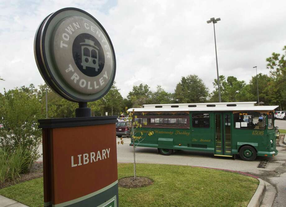 A trolley with The Woodlands trolley system is seen at the Montgomery County South Regional Library. The Woodlands Township has expanded the Town Center Trolley to include service to Hughes Landing, beginning immediately. Photo: Jason Fochtman, Staff Photographer / Houston Chronicle / © 2017 Houston Chronicle