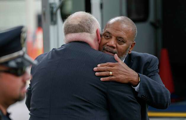 Fred McClure (right) receives a hug after returning to the Second Baptist Church campus after attending Former First Lady Barbara Bush's funeral  Saturday, April 21, 2018, in Houston. Photo: Steve Gonzales, Houston Chronicle / © 2018 Houston Chronicle