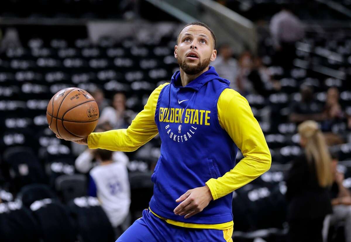 Golden State Warriors guard Stephen Curry (30) warms up before Game 3 of the team's first-round NBA basketball playoff series against the San Antonio Spurs in San Antonio. Curry has been cleared to take part in modified practices but will be out at least one more week with a left knee injury. The Warriors said Curry was examined by the team's medical staff Friday and is making progress in recovering from the grade 2 left MCL sprain that has sidelined him since March 23.