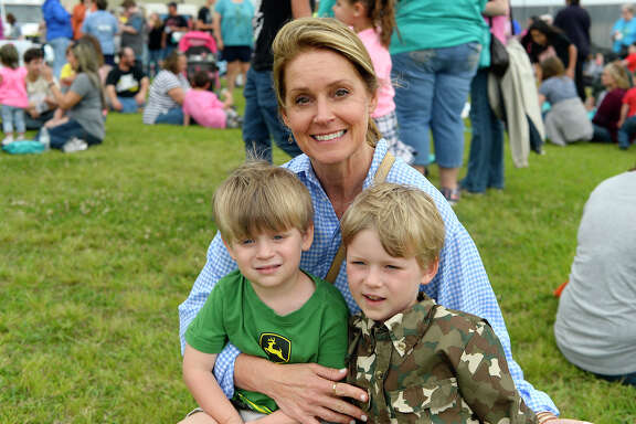 Teri Morgan with grandsons Jack and Jude Pyburn during the Harbor Foundation's 9th annual butterfly release at Ford Park. The event served as a memorial to people who have passed away and to raise money for the hospice organization.  Photo taken Saturday 4/21/18 Ryan Pelham/The Enterprise