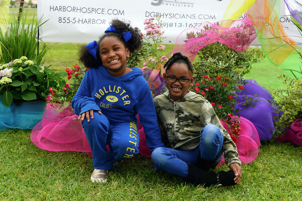 Jayci Jones and Kylei Lavergne during the Harbor Foundation's 9th annual butterfly release at Ford Park. The event served as a memorial to people who have passed away and to raise money for the hospice organization.  Photo taken Saturday 4/21/18 Ryan Pelham/The Enterprise