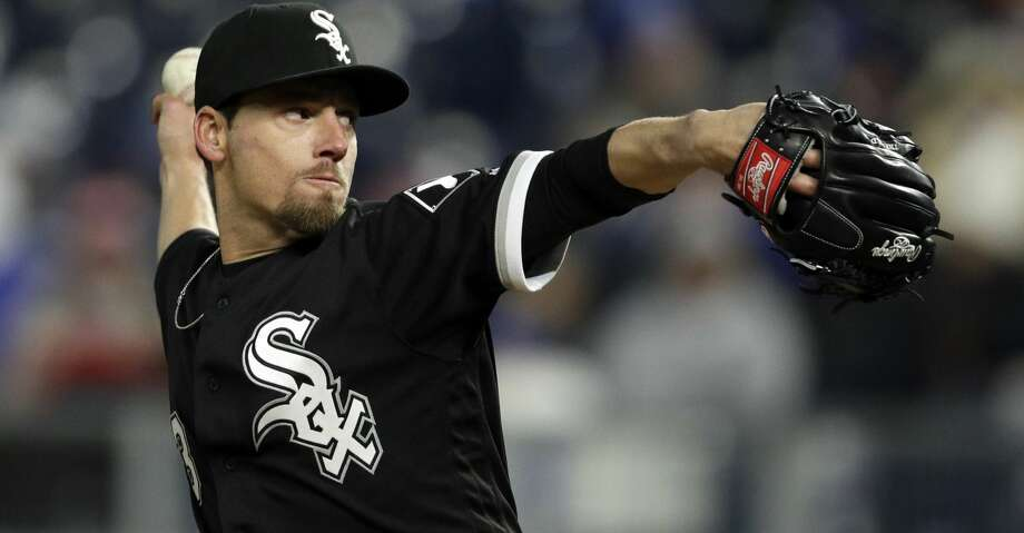 Tests revealed White Sox reliever Danny Farquhar suffered a brain hemorrhage caused by a ruptured aneurysm when he collapsed in the dugout during the sixth inning of Friday evening's game against the Astros. Photo: Orlin Wagner/Associated Press