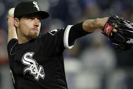 Chicago White Sox relief pitcher Danny Farquhar during a baseball game against the Kansas City Royals at Kauffman Stadium in Kansas City, Mo., Saturday, March 31, 2018. (AP Photo/Orlin Wagner)