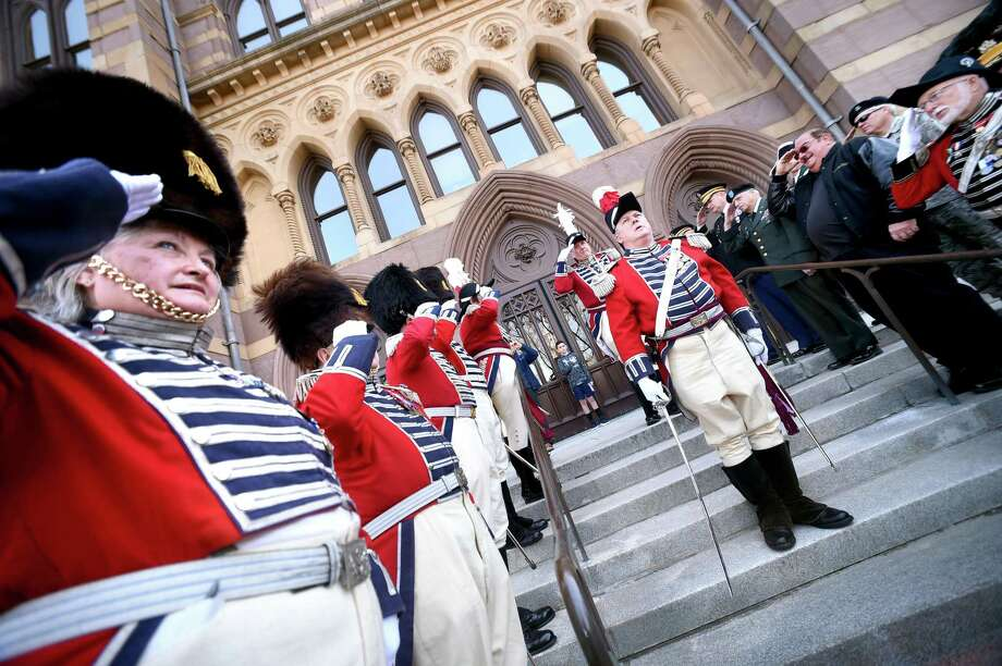 Major Commandant Richard Greenalch (right) of the 2nd Company Governor's Foot Guard portraying Capt. Benedict Arnold prepares for a battalion review after demanding and receiving the keys to New Haven Colony's powder house in front of City Hall in New Haven on April 21, 2018. Photo: Arnold Gold / Hearst Connecticut Media / New Haven Register