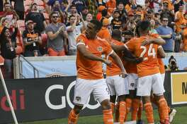 Houston Dynamo forward Mauro Manotas (9) is excited about Alberth Elis's goal during the first half of the MLS game against the Vancouver Whitecaps at BBVA Compass Stadium on Saturday, March 10, 2018, in Houston. ( Yi-Chin Lee / Houston Chronicle )
