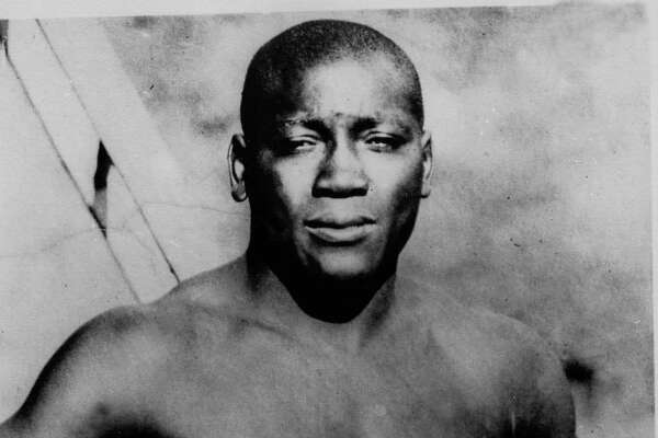"FILE - This undated photo shows boxer Jack Johnson.  President Donald Trump says he's considering ""a Full Pardon!"" for boxing's first black heavyweight champion more than 100 years after Jack Johnson was convicted by all-white jury of ""immorality"" for one of his relationships. Trump tweets that the actor Sylvester Stallone called him to share Johnson's story. Trump says Johnson's ""trials and tribulations were great, his life complex and controversial.""  The president adds: ""Others have looked at this over the years, most thought it would be done, but yes, I am considering a Full Pardon!""  (AP Photo/File"