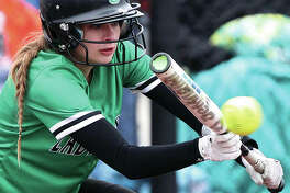 Carrollton's Kennedy Ruyle, shown bunting in a game earlier this season, had two doubles and three RBIs Friday in the Hawks' loss to the Jersey Panthers in Carrollton.
