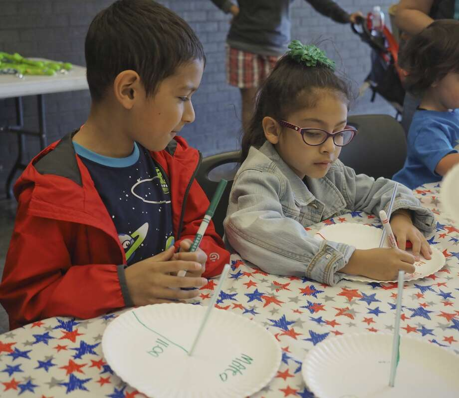 Mateo Carrasco watches as his sister, Ave, colors her sun dial 04/21/18 during Astronomy Day Blakemore Planetarium. Tim Fischer/Reporter-Telegram Photo: Tim Fischer/Midland Reporter-Telegram