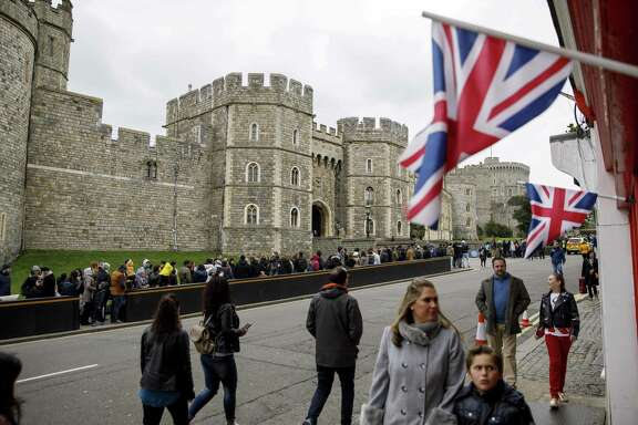 Tourists walk outside the main entrance of Windsor Castle in Windsor, west of London.