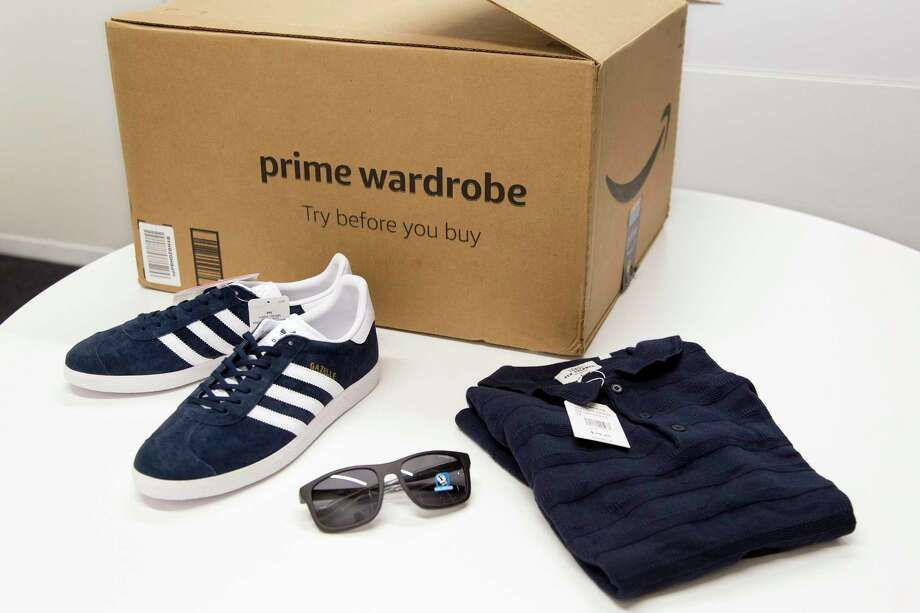 In this April 12, 2018 photo, items ordered through Prime Wardrobe are  displayed in