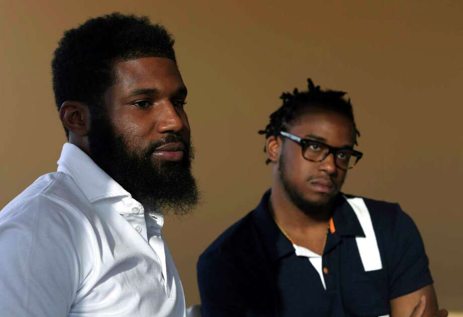 In this Wednesday, April 18, 2018 photo, Rashon Nelson, left, and Donte Robinson, right, listen to a reporter's question during an interview with The Associated Press in Philadelphia. Their arrests at a local Starbucks quickly became a viral video and galvanized people around the country who saw the incident as modern-day racism. In the week since, Nelson and Robinson have met with Starbucks CEO Kevin Johnson and are pushing for lasting changes to ensure that what happened to them doesn't happen to future patrons. (AP Photo/Jacqueline Larma) Photo: Jacqueline Larma / Copyright 2018 The Associated Press. All rights reserved.