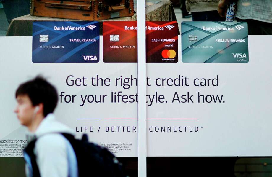 FILE- In this Jan. 21, 2018, file photo, a credit card advertisement decorates a bank's window in Atlanta. Credit card tips might be easier to understand when they're binary, do this, don't do that, but that advice usually doesn't apply to everybody. In fact, some advice could hurt more than help. (AP Photo/David Goldman, File) Photo: David Goldman / Copyright 2018 The Associated Press. All rights reserved.