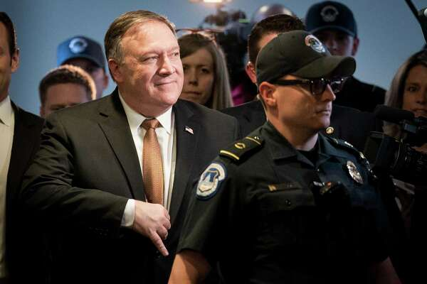 Mike Pompeo, the director of the Central Intelligence Agency, heads to a meeting on Capitol Hill. Support voiced on Thursday by a key Democratic senator means that Pompeo is all but assured of being confirmed as President Donald Trump's second secretary of state.