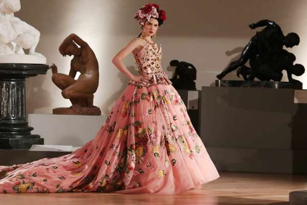 San Antonio socialite Maya Henry opened the Dolce & Gabbana Alta Moda Alta Sartoria fashion show at the Soumaya Museum in Mexico City wearing a floral embroidered and jewel encrusted Dolce & Gabbana couture gown.