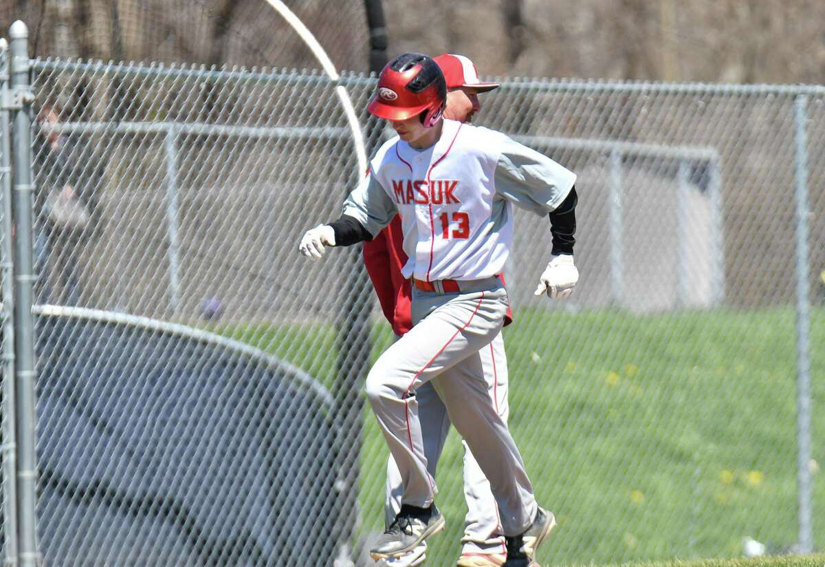 Matt Wittenberger (13) of the Masuk Panthers rounds third base after hitting a home run during a game against the Staples Wreckers at Staples High School on Saturday April 21, 2018 in Westport, Connecticut.