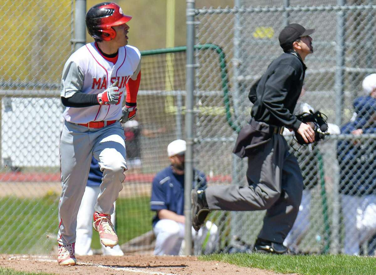 Enzo Merlonghi (5) of the Masuk Panthers watches his ball clear the left field fence for a home run a during a game against the Staples Wreckers at Staples High School on Saturday April 21, 2018 in Westport, Connecticut.