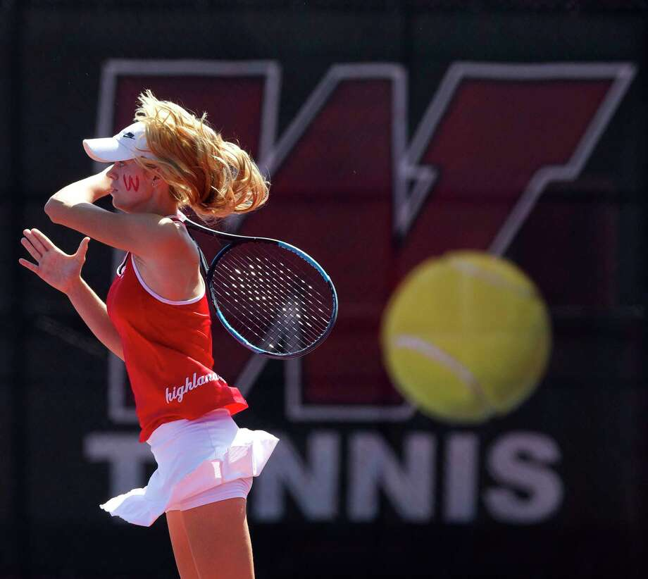 Avery Hilbig of The Woodlands returns a serve during the District 12-6A tennis tournament at The Woodlands High School, Thursday, April 5, 2018, in The Woodlands. Photo: Jason Fochtman, Staff Photographer / © 2018 Houston Chronicle