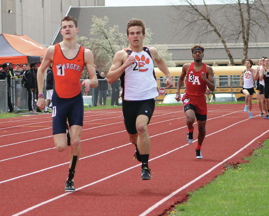 Carthage Illini West senior Jacob Bryan (left) and Edwardsville senior Franky Romano (middle) battle for the lead while Alton's Cassius Havis runs third on the backstretch of the final lap in the 800 meters Saturday at the Winston Brown Invite at Winston Brown Track in Edwardsville. Bryan won the race in 1:56.43, with Romano second in 1:57.86 and Havis third in 2:02.72. Photo:     Greg Shashack / The Telegraph