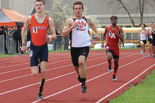 Carthage Illini West senior Jacob Bryan (left) and Edwardsville senior Franky Romano (middle) battle for the lead while Alton's Cassius Havis runs third on the backstretch of the final lap in the 800 meters Saturday at the Winston Brown Invite at Winston Brown Track in Edwardsville. Bryan won the race in 1:56.43, with Romano second in 1:57.86 and Havis third in 2:02.72.