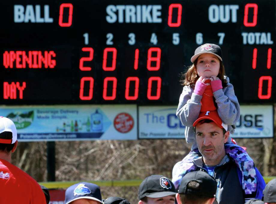 Joe Swift, coach of the Timber Rattlers little league team, holds his daughter Margaret, 6, on his shoulders during Fairfield American Little League Opening Day festivities at Mill Hill School in Fairfield, Conn., on Saturday Apr. 21, 2018. Photo: Christian Abraham, Hearst Connecticut Media / Connecticut Post