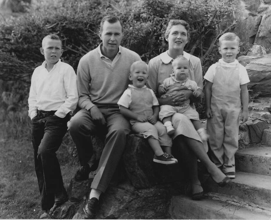 HS728   The Bush Family (l to r:  George W., George Bush, Neil, Marvin being held by Barbara, and Jeb), Midland, TX, circa 1957. Photo Credit:  George Bush Presidential Library  and Museum                       Courtesy Mrs. Barbara Bush