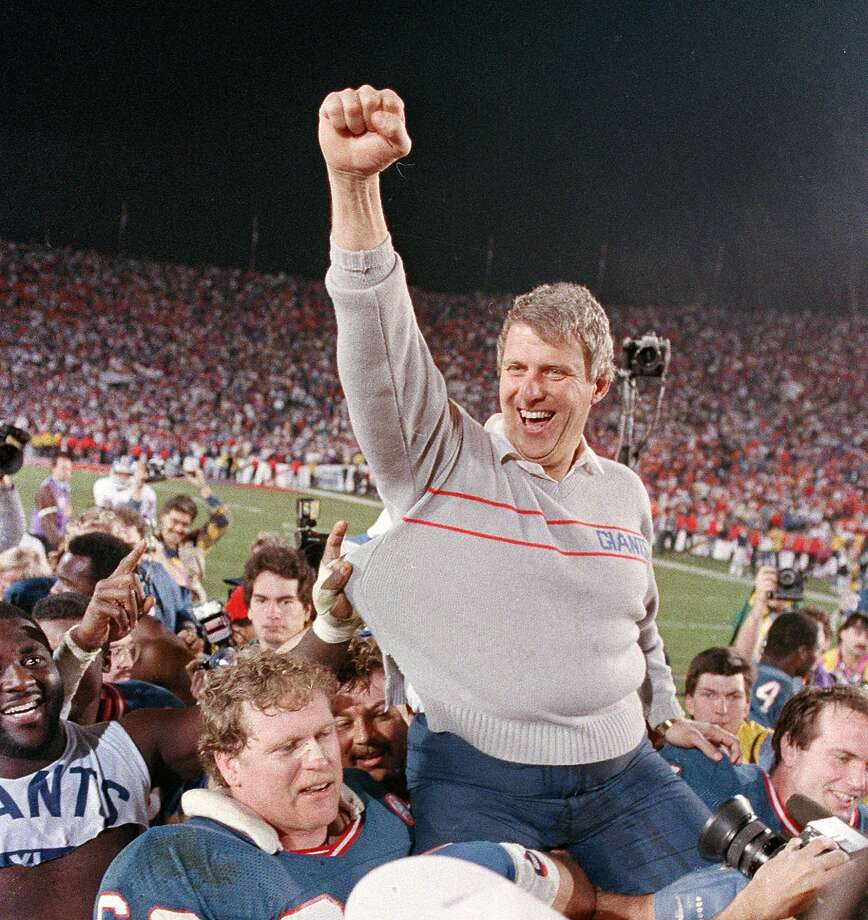 FILE - In this Jan. 25, 1987, file photo, New York Giants coach Bill Parcells is carried off the field after the Giants defeated the Denver Broncos, 39-20, in Super Bowl XXI in Pasadena, Ca. Parcells will enter the Pro Football Hall of Fame in Canton, Ohio, Sunday, Aug. 4, 2013. (AP Photo/Eric Risberg, File) Photo: Eric Risberg, AP