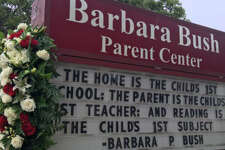 A sign at the Barbara Bush Parent Center in College Station pays homage to the former first lady at her funeral procession on April 21, 2018.