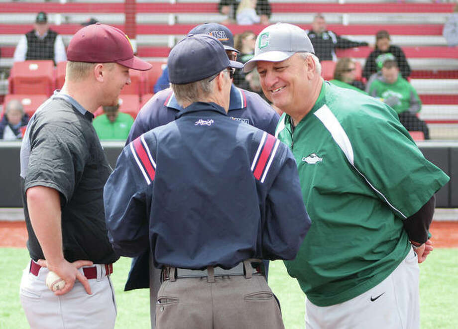 Carrollton coach Jeff Krumwiede (right) shares a laugh with umpire Barry Wright during the exchanging of scorecards with Dieterich coach Josh Krumwiede at home plate Saturday at SIUE's Simmons Baseball Complex in Edwardsville. Photo:       Greg Shashack / The Telegraph