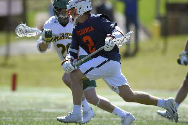 Virginia's Michael Kraus, of New Canaan, drives in for the winning goal against Vermont's Spencer Decker, of Stamford, during the Cavaliers' 10-9 victory on Saturday at Dunning Field in New Canaan.