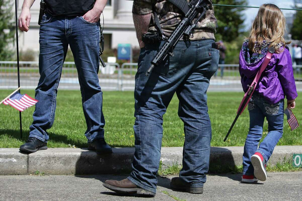 """Over 1,000 people gathered at the state capital in Olympia, Saturday, for the """"March for our Rights"""" gun rights rally, April 21, 2018. Speakers opposed gun legislation proposed in the wake of recent school shootings and national gun violence."""