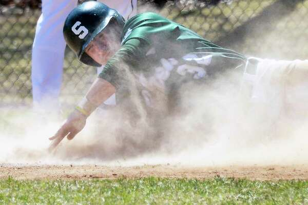 Shen's #32 Joe Novenche slides into home plate to score on a passed ball during Saturday's game  against Mamaroneck High April 21, 2018 in Clifton Park, NY.  (John Carl D'Annibale/Times Union)