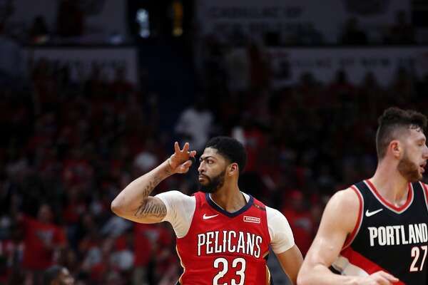 New Orleans Pelicans forward Anthony Davis (23) reacts after making a 3-point shot during the first half of Game 4 of a first-round NBA basketball playoff series against the Portland Trail Blazers in New Orleans, Saturday, April 21, 2018. (AP Photo/Scott Threlkeld)