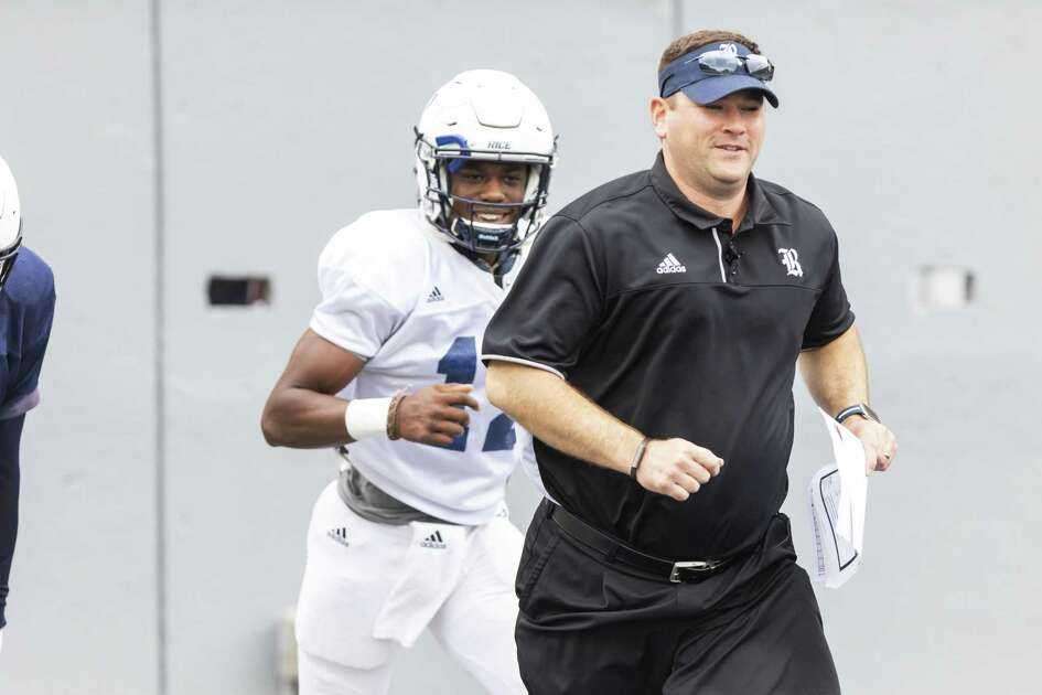 Rice head coach Mike Bloomgren runs onto the field before the Rice spring football game at Rice Stadium on Saturday, Apr 21, 2018, in Houston, Texas. (Joe Buvid / For the Chronicle)