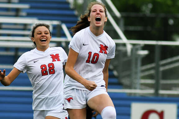 Houston Memorial senior midfielder Grace Yochum (10) celebrates her goal scored in the opening minutes against Lewisville Marcus with teammate sophomore midfielder Kelsey Hranicky (22) during their UIL Class 6A State Final Girls Soccer matchup at Birkelbach Field in Georgetown on April 21, 2018. (Photo by Jerry Baker/Freelance)